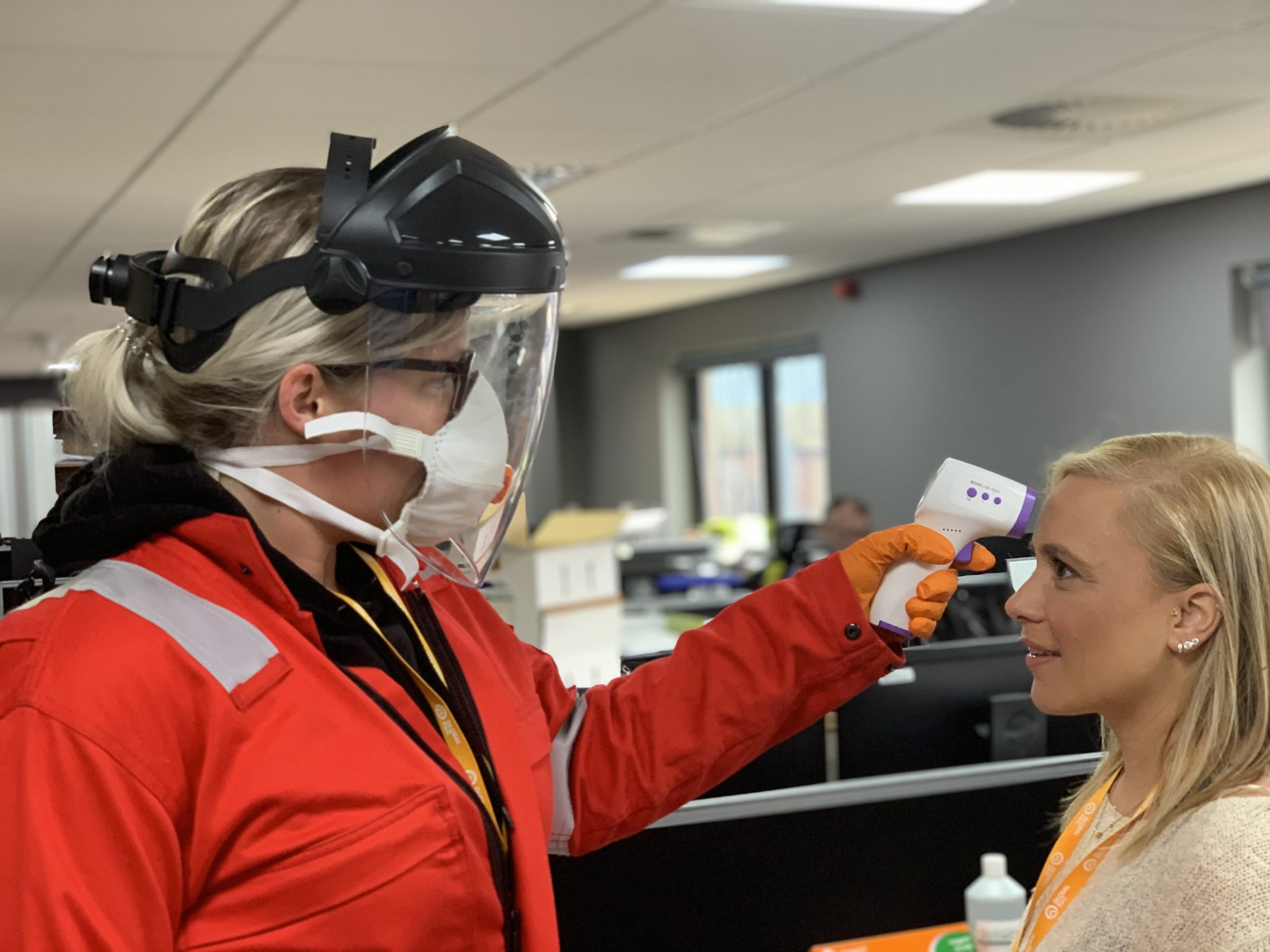 GE Group staff undergoing temperature testing for COVID-19